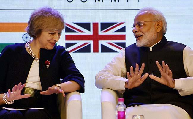 PM Modi and UK Theresa